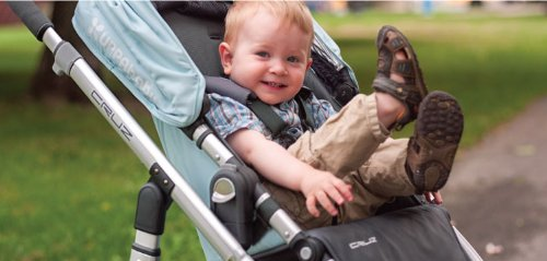 happy kid in Uppababy Cruz Stroller